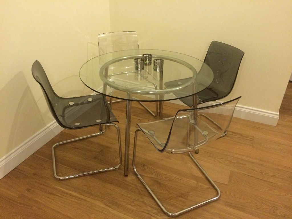 ikea salmi glass dining table and 4 x tobias transparent dining chairs in chelmsford essex. Black Bedroom Furniture Sets. Home Design Ideas