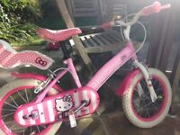Halfords Hello Kitty bike for sale in good condition. Ideal learners bike with bell and stabilisers.