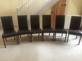 Six brown leather dining chairs