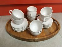 Set of white porcelain cups and saucers