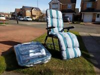Two new unused multi-position sun loungers, one still in packaging. Good weather not included.