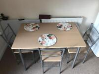Dining Table with 4 chairs.
