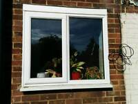 Almost new white UPVC window