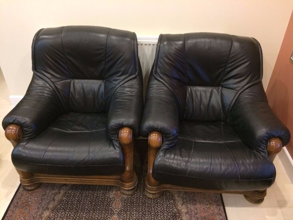 Armchairs Leather and Wood x 2in LondonGumtree - 2 x Black Leather and Wood Armchairs Used, Smoke and pet free home, Collection only