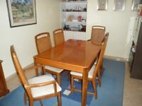 BEAUTIFUL OAK DINING TABLE EXTENDS TO SEAT 8. COMPLETE WITH 8 CHAIRS INCLUDING 2 CARVERS