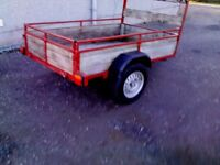 like new 6 x 4 car trailer, lights,ladder rack, tie rail, tongue and groove wood,
