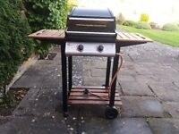 Deluxe Gas Barbecue with weatherproof cover.
