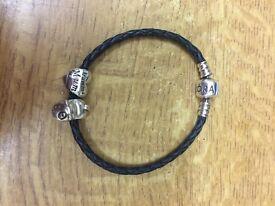 Pandora leather bracelet and 2 charms