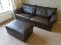 Very Large Leather Sofa seats up to 4. With matching footstool.