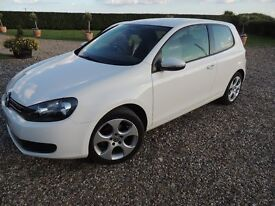 Imaculate VW GOLF 1.4 in stunning unmarked white two lady owners only.
