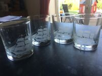 4 glass tumblers with nautical etched design