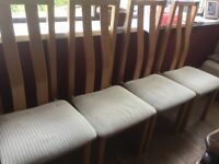 Four dining room chairs, with fabric seats and wood backs