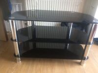 Black glass tv stand, 1 small scratch otherwise excellent condition, Argos price new £69.99