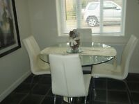 Round Glass Table (Marks & Spencer) with 4 white chairs