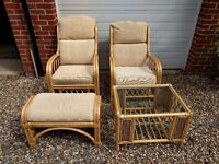 Rattan framed conservatory furniture - 2 chairs, footstool and glass topped table for sale