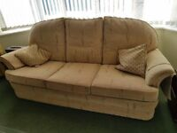 Upholstered sofa and matching armchair