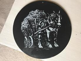 Picture of a working horses on slate