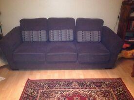 Charcoal sofa and Samsung smart TV