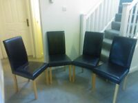 Four Brown Dining Chairs