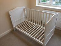 White Mothercare nursery furniture, cot bed, single wardrobe and chest of drawers.
