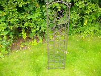 """Wine Rack ---- Free Standing Black Cast Iron, will hold 30 Bottles. Measures 45"""" X 11""""."""