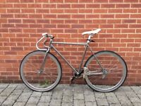 Fixie Bike fitted with custom pedals and accessories