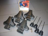 Thule Rapid System 750 Footpack and Thule 3110 adaptor kit.