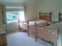 Two single pine beds with mattresses
