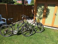His and Hers matching Trek Navigator 200 Mountain/Road bikes