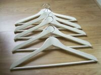 15 WHITE WOODEN COATHANGERS GOOD CONDITION WILL SPLIT INTO SETS OF 5