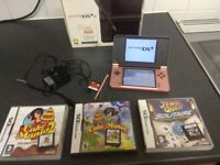 nintendo dsi xl console and 5 game cartridges with charger and stylus