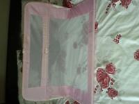 pink and white lindam bed guard