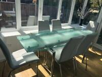 Glass top table and 6 leather dining chairs