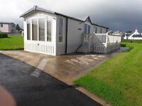 PVC DECKING WITH LOCKABLE GATE AND FITTED SKIRTING FOR CARAVAN