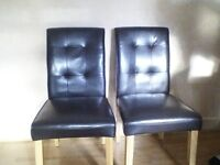 Two brown faux leather dining chairs real bargin