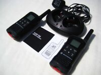 A pair of lightly used Motorola T60 walkie talkies, good condition in original packaging