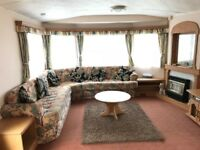 Atlas Everglade Super 2 beds en-suite static caravan for sale with wooden decking and great views