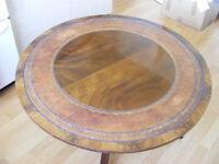 Mahogany pedestal coffee table.