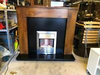 Dark wooden fireplace with electric fire