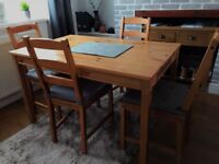 Oak wood dining / kitchen table + 4 chairs with grey Ikea cushion seat covers