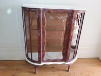 An attractive Art Deco Cocktail Cabinet with curved front and decorative panel to the front.