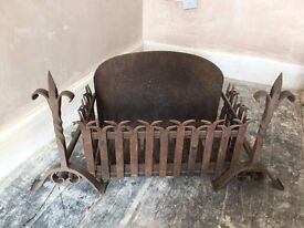 Two iron firedogs/Andiron and grate to place wooden logs on for burning in the fireplace