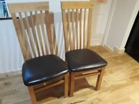 Pair of solid wood dining chairs for sale