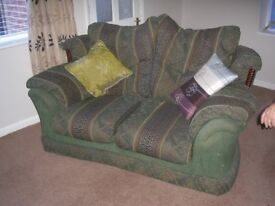 2 Seater sofas x 2 and a matching arm chair.Green Fabric.