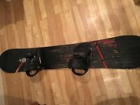 Practically brand new men's Salomon snowboard complete with bindings and boots for sale
