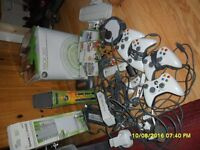 xbox 360 huge lot games ,controllers remote and sky landers etc