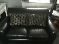 Two 2 Seater Black Leather Sofa's Settees