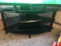 Black glass corner tv stand.