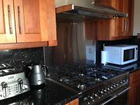 Used kitchen cabinets. Smeg integrated dishwasher, Smeg range cooker,Smeg extractor hood.