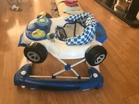 Boys blue baby walker, it as a removable toy that plays music and light up.